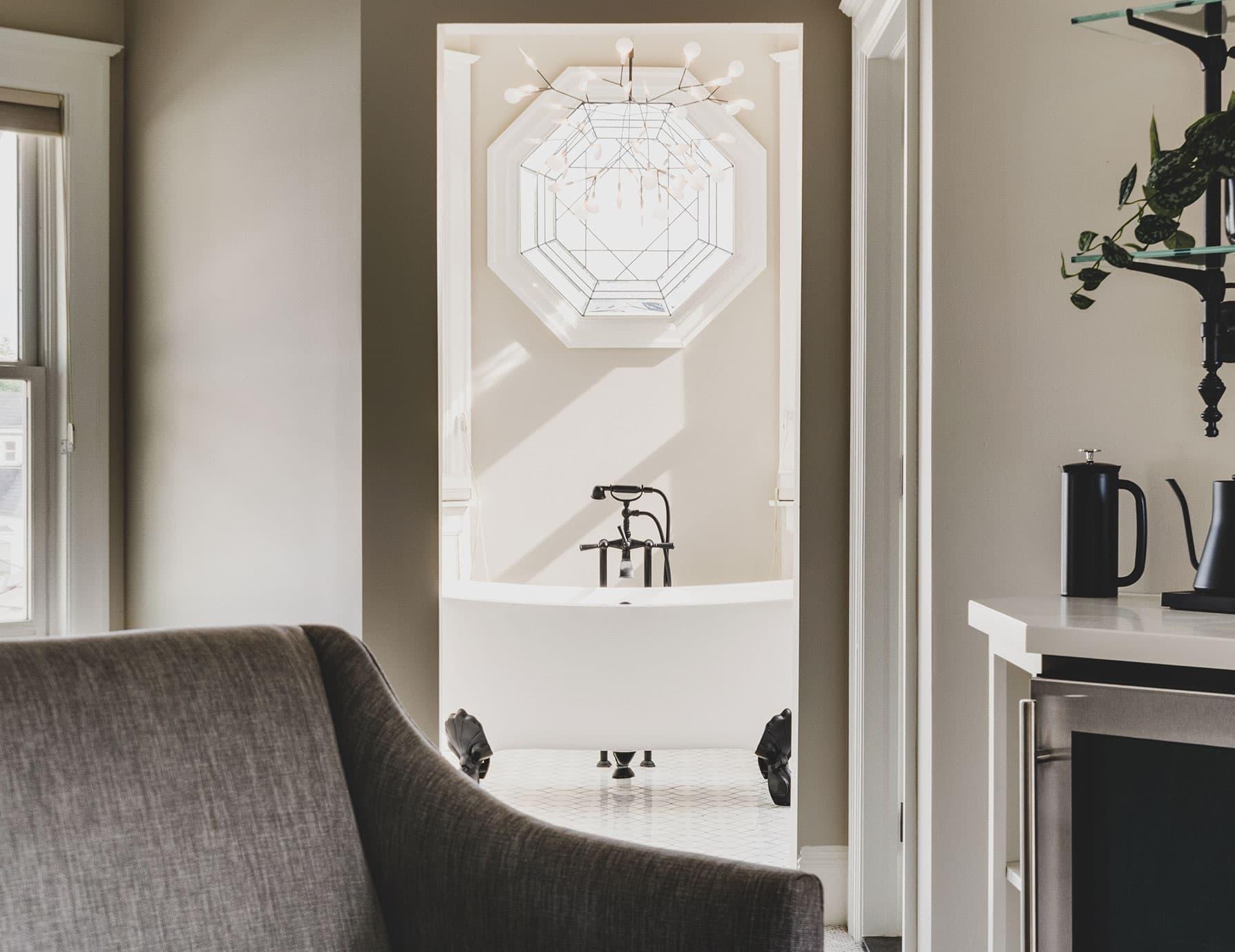 Lark Suite view of bathtub through doorway