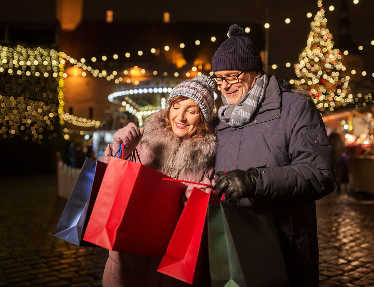 Senior couple shopping at a Christmas festival