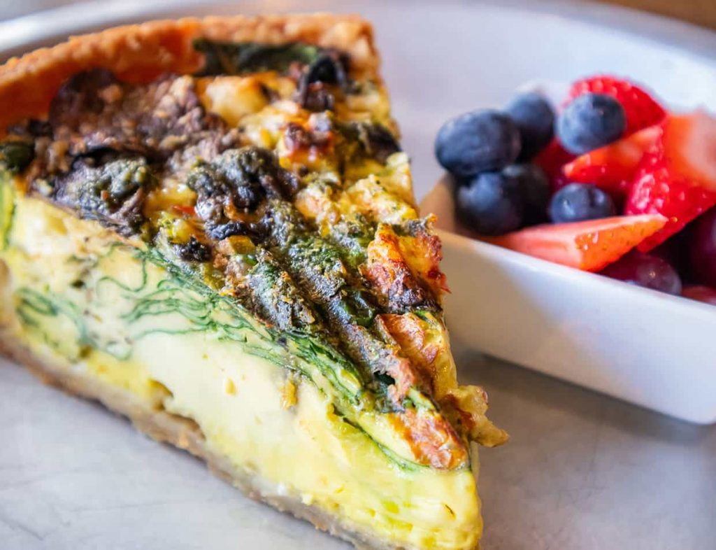 Breakfast including quiche and fruit