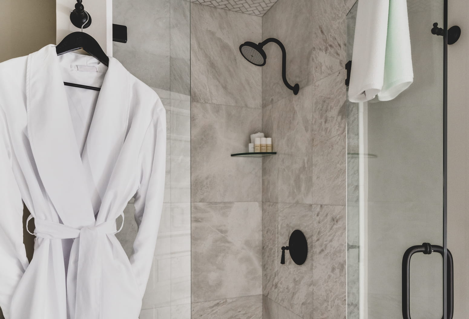 Sparrow Room Shower with a robe hanging on the hook